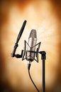 Professional singing microphone on abstract grunge background Stock Images
