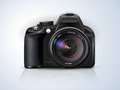 Professional slr camera black on a grey background with the reflection of the Stock Photography