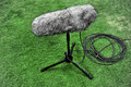 Professional sport microphone detail with a on artificial turf Stock Photo