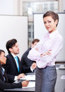 Professional successful business woman in office smiling Royalty Free Stock Photo