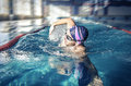 Professional swimmer crawl freestyle in a swimming pool Stock Photography