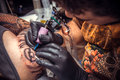 Professional tattooer at work in tatoo salon Royalty Free Stock Photo