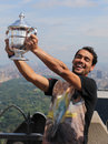 Professional tennis player fabio fognini posing with us open trophy won by flavia pennetta on the top of the rock new york city Royalty Free Stock Photos