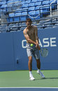 Professional tennis player jerzy janowicz practices for us open at louis armstrong stadium flushing ny august billie jean king Royalty Free Stock Photo