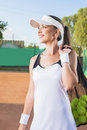 Professional Tennis Woman With Mesh tennis Bag at Court Stock Images