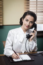 Professional vintage secretary on the phone Royalty Free Stock Photo