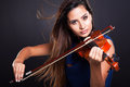 Professional violinist on black background Royalty Free Stock Photography