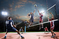 Professional volleyball players in action on the night court Royalty Free Stock Photo