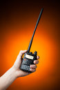 Professional walkie talkie radio in hand on orange background Stock Images