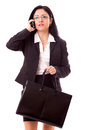 Professional woman calling pretty lady in black suit from cell phone Royalty Free Stock Photo