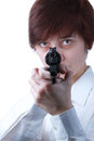 Professional woman with a gun who is holding pointing it at target on white background Royalty Free Stock Image