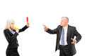 Professional woman showing a red card and blowing a whistle to h women her boss isolated on white background Stock Image