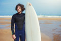 Professional young surfer  waiting for the tide to ride the big waves Royalty Free Stock Photo