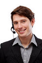 Professional young telemarketer handsome in headphones smiling Stock Image