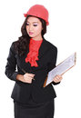 Professional young woman contractor carrying building plan Royalty Free Stock Photo