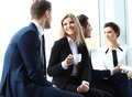 Professionals chatting during a coffee break young couple of Royalty Free Stock Image