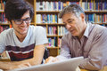 Professor assisting a student with studies Royalty Free Stock Photo
