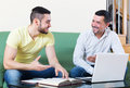 Professor giving lesson to student smiling private happy at home Stock Photo