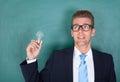 Professor masculino novo holding light bulb Imagens de Stock