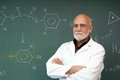 Professor stands in front of a blackboard Royalty Free Stock Photo