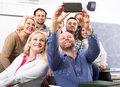 Professor taking a selfie with students Royalty Free Stock Photo