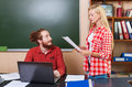Professor Using Laptop Computer Looking At Young Student Girl Hold Paper Sheets Document Report, University Teacher Royalty Free Stock Photo