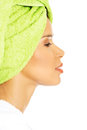 Profile of attractive woman wrapped in towel with turban isolated on white Stock Photos