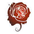 Profile of a beautiful girl with a rose Royalty Free Stock Photo