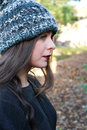 Profile of a beautiful teenage girl wearing a pom pom hat Royalty Free Stock Photo