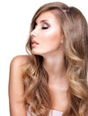 Profile of a beautiful woman with long wavy hair young and makeup isolated on white Stock Photo