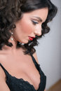 Profile of a beautiful young brunette woman in black babydoll Royalty Free Stock Photo
