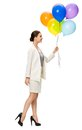 Profile of business woman with balloons full length walking colorful isolated on white concept leadership and success Stock Photo