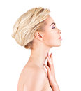 Profile face of young woman touching neck isolated on white background Royalty Free Stock Image
