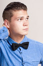 Profile of gallant man in the blue shirt with black bow tie Royalty Free Stock Images
