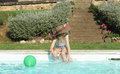 Profile of a girl with hat playing at pool's edge Royalty Free Stock Photo