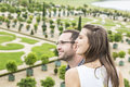 Profile of a happy young couple porfile enjoying beautiful french garden during beautiful day the fous is selective on the woman Royalty Free Stock Photography