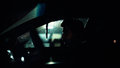 Profile of a man in car on dark night. Royalty Free Stock Photo