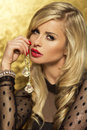 Profile portrait of attractive blonde lady sensual beauty with red lips looking at camera Royalty Free Stock Images