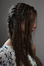 Profile portrait of fashion female brunette with braids Royalty Free Stock Photo