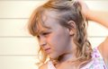 Profile portrait of a little blond beautiful girl Royalty Free Stock Photos