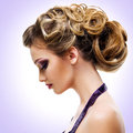 Profile portrait of woman with fashion hairstyle over creative background Stock Image