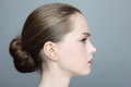 Profile portrait young beautiful girl hair bun Stock Photos