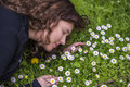 Profile portrait of young girl lying in a bed of white daisy wildflowers Royalty Free Stock Photo