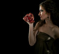 Profile portrait young girl with pomegranate Royalty Free Stock Photos