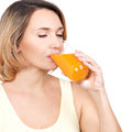 Profile portrait of a young woman drinks orange juice isolated on white Royalty Free Stock Photos