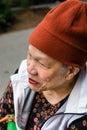 Profile of senior women smiling woman wearing warm cap Royalty Free Stock Image