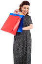 Profile shot of woman holding shopping bags Royalty Free Stock Photography