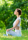 Profile of sportive woman in asana position zen gesturing girl who sits concept healthy lifestyle and relaxation Stock Photo