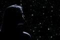 Profile on stars sad female sky background toned image with copyspace Royalty Free Stock Photo