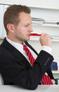 Profile of stressed business man chewing pen thinking about life Stock Photo